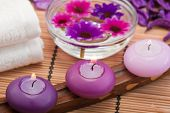 pic of swedish sauna  - three purple toned candles and flowers in spa setting - JPG