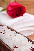 stock photo of swedish sauna  - aromatic rose bathing salt with rose on white towel - JPG