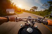 image of pov  - Driver riding motorcycle on the empty asphalt road - JPG