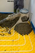 stock photo of convection  - Installing underfloor heating and colling pipes modern system - JPG