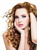 stock photo of beautiful woman  - Young beautiful woman with long curly hairs  - JPG