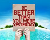 stock photo of empower  - Be Better Than You Were Yesterday card with a beach on background - JPG