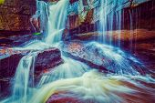 image of waterfalls  - Vintage retro effect filtered hipster style image of tropical waterfall - JPG