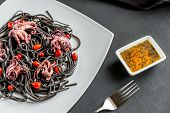 stock photo of cuttlefish  - Pasta With Black Cuttlefish Ink And Small Octopuses