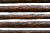 foto of log cabin  - Close up of an Exterior Log Cabin Wall with Chinking - JPG