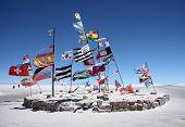 picture of south american flag  - Flags in a salt desert of Salar de Uyuni - JPG