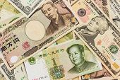 stock photo of yuan  - Colorful of World banknotes background - JPG