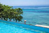 stock photo of infinity pool  - Enjoy the ocean view infinity pool on vacation - JPG