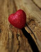 picture of heartfelt  - Red heart on a wood background  - JPG