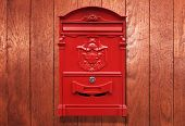 stock photo of mailbox  - Red mailbox for letters weighs on the wall - JPG