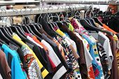 foto of flea  - retro and vintage clothes of many colors for sale at flea market - JPG