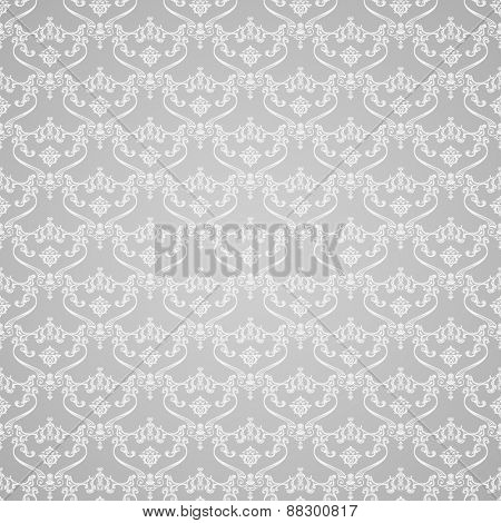 Vector seamless vintage background. Calligraphic pattern. Royal elegant ornament white