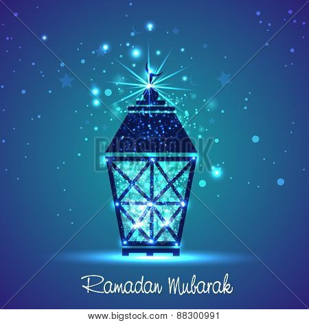 Shiny blue Arabic lamp on stars and moons decorated background for holy month of Muslim community Ramadan Kareem celebration.