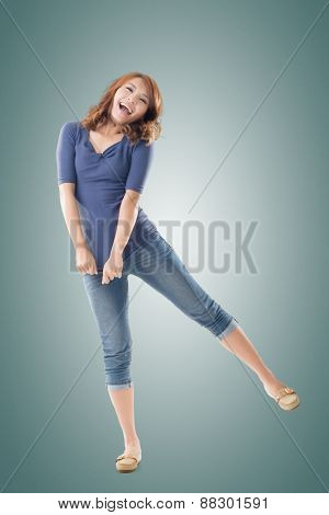 Excited Asian young girl, full length portrait isolated.