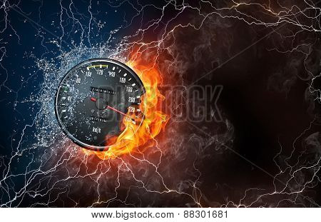 Speedometer on fire and water with lightening around on black background. Horizontal layout with text space.