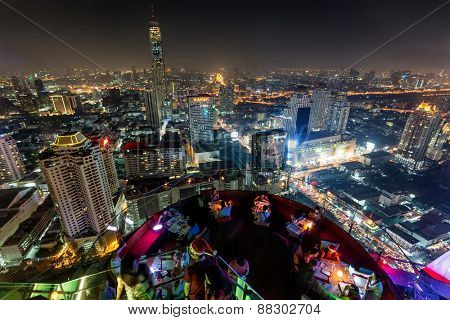 BANGKOk, THAILAND, DECEMBER 25, 2014: Night Bangkok skyline view from the Centara hotel rooftop in Central World district, Bangkok, Thailand
