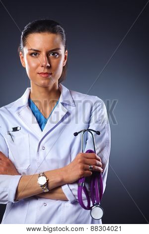 Portrait of young female doctor holding a stethoscope