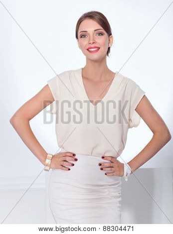 Portrait of a smiling business woman standing .