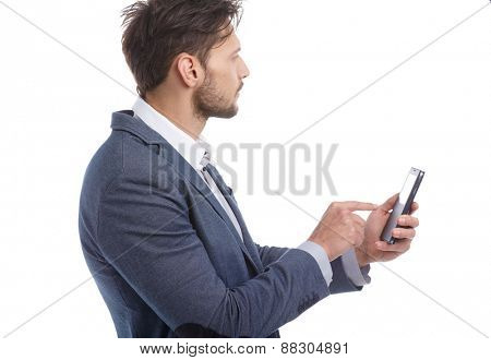 Young businessman talking on mobile isolated on white background
