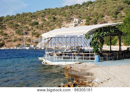 MEGANISSI, GREECE - AUGUST 31, 2008: The beach taverna at Spilia Bay on the Greek island of Meganissi. With a population of around 1100 people, the Ionian island is a satellite of nearby Lefkada.