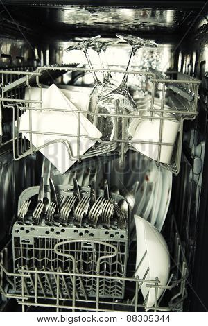Details Of Open Dishwasher, Utensils With Drops In During Washing