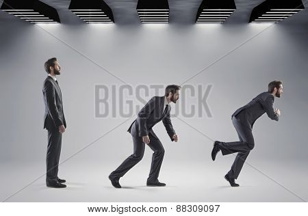 Many businessmen running in the same direction