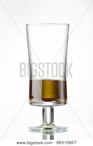 glass with olive oil on white