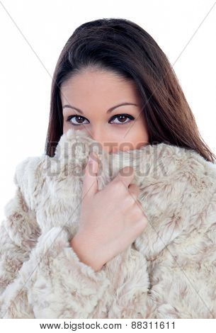 Young brunette girl in a grey coat wrapping up