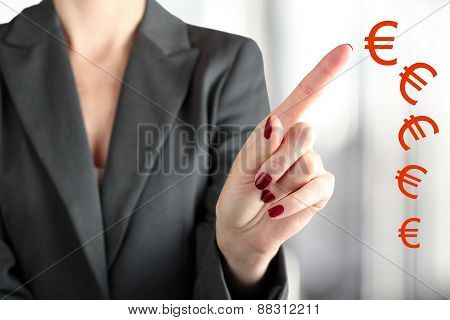 Businesswoman Touching  Euro  By Finger