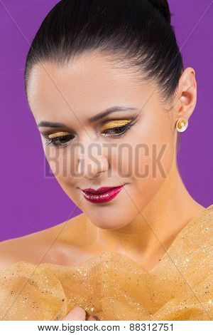 Girl with a professional makeup posing on a purple background