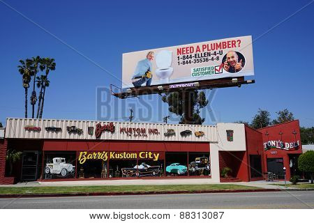 LOS ANGELES - APR 17: Matt Lauer pranks Ellen DeGeneres with a huge billboard in which she is shown as a plumber on April 17, 2015 in Los Angeles, California