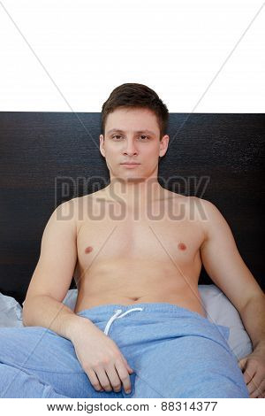 Erotic Man With Naked Torso Lying In Bed