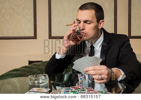 Young guy in the casino at the gaming table