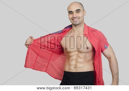 Man Smiling Showing Abs.