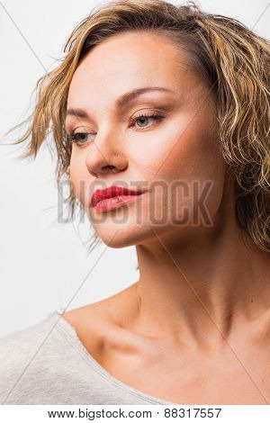 Beautiful blonde on light background
