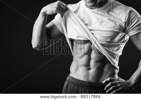 Muscular man bodybuilder. Man posing on a black background,