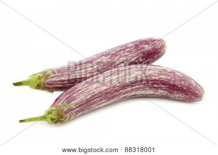 two striped aubergines on a white background