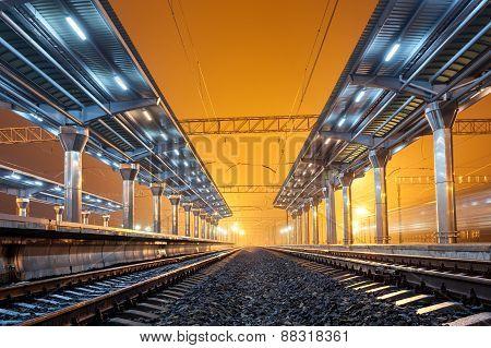 Railway Station At Night. Train Platform In Fog. Railroad