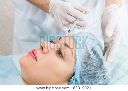 Subcutaneous injection into the girl's face.