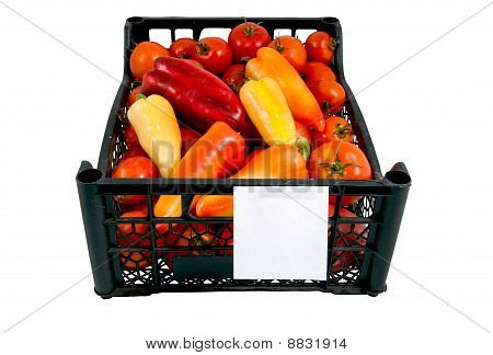 The Box Of Bright Red And Green Tomatoes And Paprica