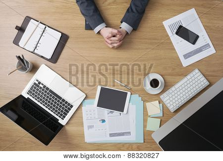 Confident Businessman With Hands Clasped