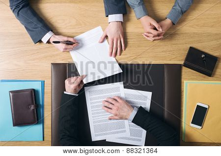 Couple Signing Marriage Documents