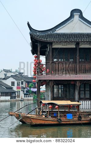 Old village by river in Shanghai with boat