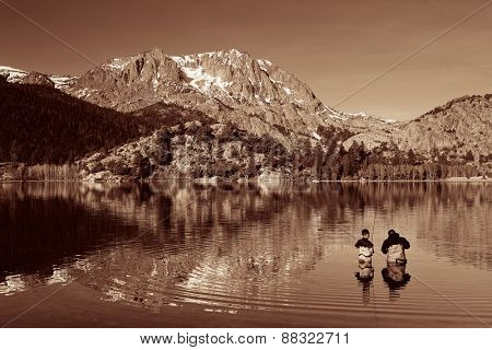 Dad fishing with son in lake in Yosemite in BW.