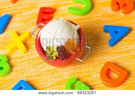 Gummy bear ice cream with colorful gummy bears as children ice cream