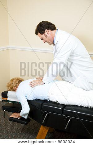 Chiropractor Manipulating Spine