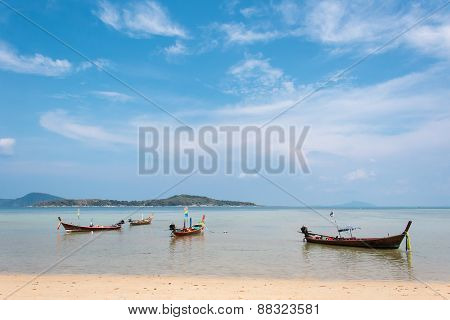 Group Of Wooden Boats At The Tropical Beach, Thailand