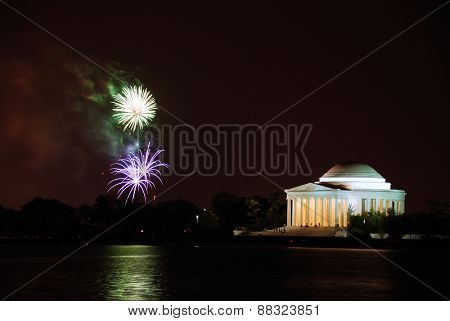Thomas Jefferson Memorial illuminated with light and fireworks. Washington DC.