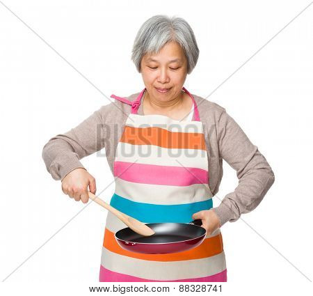 Old woman making food