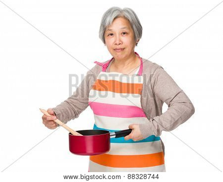 Old woman cooking food